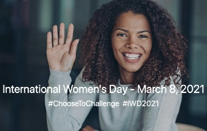 A woman smiles and waves her hand. Text in the image says International Women's Day March 8 2021. #ChooseToChallenge #IWD2021